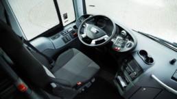 MAN Lion's Regio L Innenansicht Fahrersitz mit Lenkrad und Armaturen - Musshoff Touristik Lippstadt